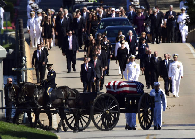 Family members, including Cindy McCain, back center, follow a horse-drawn caisson that carries the casket of Sen. John McCain, R-Ariz., as it proceeds to the United States Naval Academy cemetery in Annapolis, Md., Sunday, Sept. 2, 2018, for burial. McCain died Aug. 25 from brain cancer at age 81. (AP Photo/Susan Walsh)