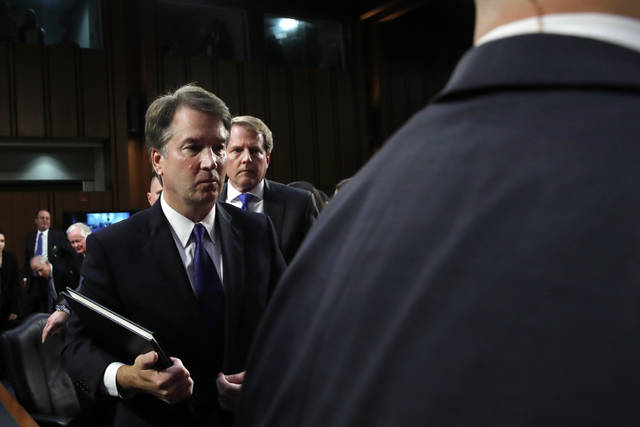 Supreme Court nominee Brett Kavanaugh, left, leaves followed by White House counsel Don McGahn, Tuesday, Sept. 4, 2018, on Capitol Hill in Washington, at the end of the first day of his Senate Judiciary Committee confirmation hearing to replace retired Justice Anthony Kennedy. (AP Photo/Jacquelyn Martin)