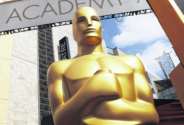 The organization that bestows the Academy Awards says it is suspending plans to award a new Oscar for popular films amid widespread backlash to the idea. The Academy of Motion Picture Arts and Sciences said it will study plans for the category further.
