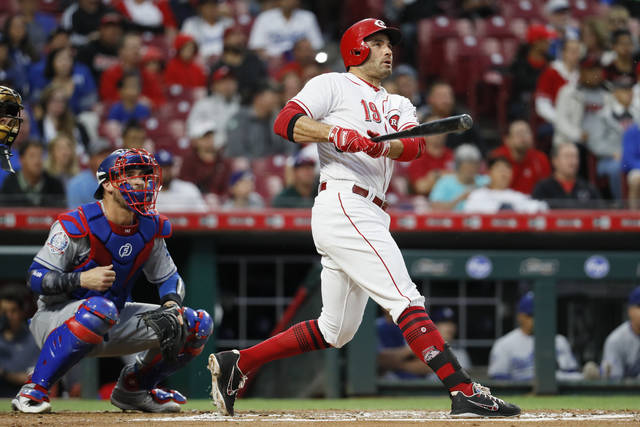 Cincinnati Reds' Joey Votto hits a two-run double off Los Angeles Dodgers starting pitcher Alex Wood in the first inning of a baseball game, Monday, Sept. 10, 2018, in Cincinnati. (AP Photo/John Minchillo)