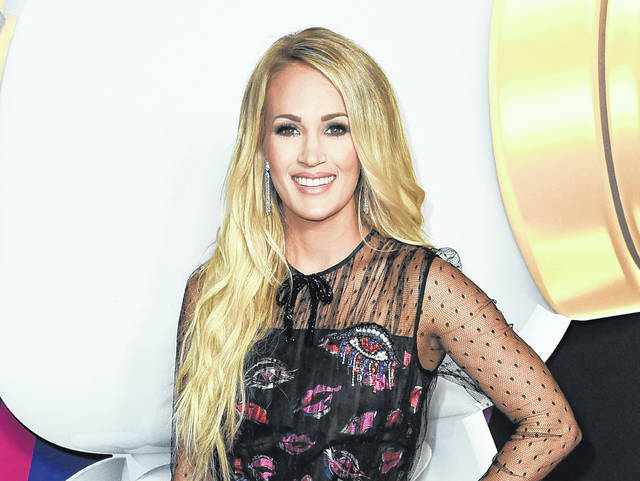 Carrie Underwood attends the 2018 Radio Disney Music Awards in June in Los Angeles. Underwood says she turned to God after experiencing three miscarriages in the past two years.