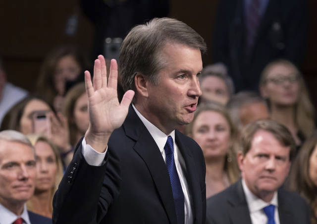 FILE - In this Sept. 4, 2018, file photo, President Donald Trump's Supreme Court nominee Brett Kavanaugh is sworn in before the Senate Judiciary Committee on Capitol Hill in Washington. Both parties are grappling with tremendous political risks in the midst of an increasingly messy Supreme Court fight. Republicans risked alienating women, particularly in the nation's suburbs, by embracing President Trump's hand-picked nominee even after allegations surfaced of decades-old sexual misconduct. Democrats, who want to delay the high-stakes nomination, risked energizing complacent Republican voters should they play politics with the sensitive allegations.