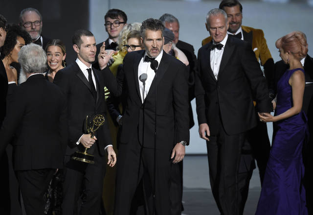 "David Benioff and the cast and crew of ""Game of Thrones"" accept the award for outstanding drama series at the 70th Primetime Emmy Awards on Monday at Microsoft Theater in Los Angeles."