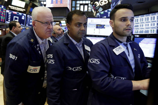 FILE- In this Aug. 31, 2018, file photo trader Thomas Ferrigno, left, works with specialists Dilip Patel, center, and Karan Virdi on the floor of the New York Stock Exchange. The U.S. stock market opens at 9:30 a.m. EDT on Wednesday, Sept. 19. (AP Photo/Richard Drew, File)