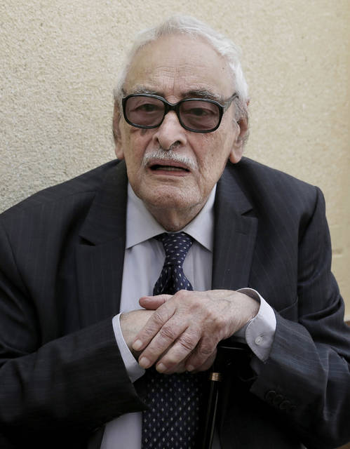 FILE - In this July 12, 2015 file photo, actor Gamil Ratib, attends a funeral in Cairo, Egypt. Ratib, an award-winning Franco-Egyptian actor whose roles as villain or aristocrat made him a household name across the Arab world, died Wednesday, Sept. 19, 2018. He was 92. Ratib appeared in about 100 films in both French and Arabic. (AP Photo/Hassan Ammar, File)