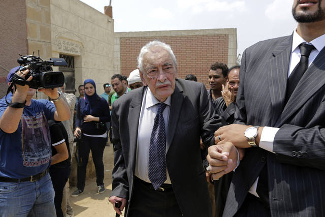 FILE - In this July 12, 2015 file photo, actor Gamil Ratib, attends a funeral in Cairo, Egypt. Ratib, an award-winning Franco-Egyptian actor whose roles as villain or aristocrat made him a household name across the Arab world, died Wednesday, Sept. 19, 2018. He was 92. Ratib appeared in about 100 films in both French and Arabic. (AP Photo/Amr Nabil, File)