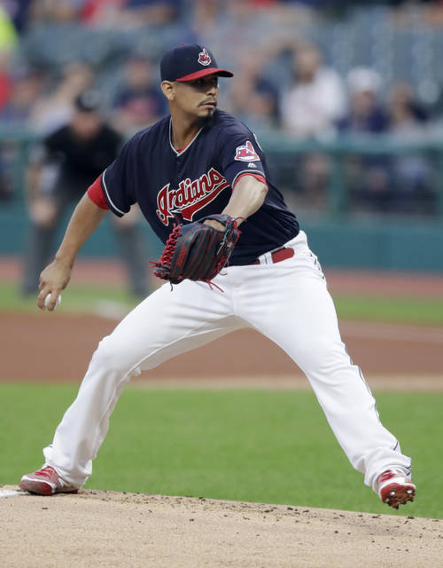 Cleveland Indians starting pitcher Carlos Carrasco delivers in the first inning of a baseball game against the Chicago White Sox, Wednesday, Sept. 19, 2018, in Cleveland. (AP Photo/Tony Dejak)