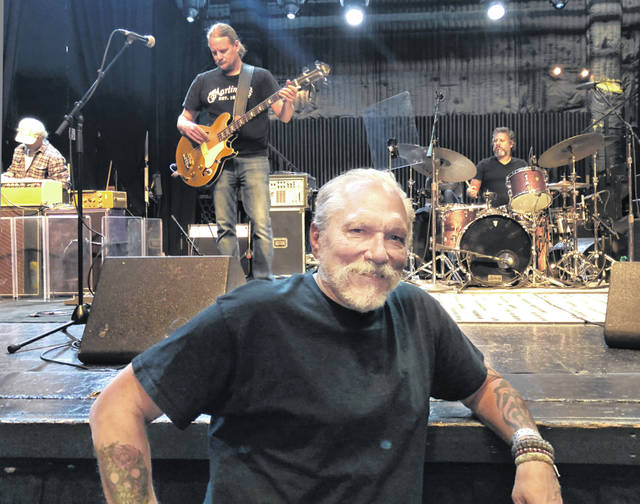 "Jorma Kaukonen, 77, poses for a photo as his Hot Tuna bandmates do a sound check before a gig Sept. 6 at the El Rey Theatre in Los Angeles. Long before he wrote and recorded the Jefferson Airplane classic ""Embryonic Journey,"" Kaukonen was on a decades-long journey of his own discovery. It began as a globe-circling embassy brat in the 1950s, continued as a psychedelic rock star in the '60s and shows no signs of slowing as the youthful co-founder Hot Tuna guitarist is still recording and touring. He stops long enough to recount much of it in his recent memoir ""Been So Long: My Life & Music."""