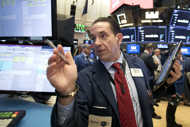 Trader Tommy Kalikas works on the floor of the New York Stock Exchange, Thursday, Sept. 20, 2018. A wave of buying sent U.S. stocks solidly higher on Wall Street Thursday, pushing the Dow Jones Industrial Average above the all-time high it closed at in January. (AP Photo/Richard Drew)