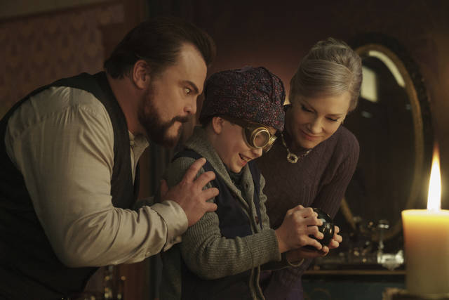 "This image released by Universal Pictures shows Jack Black, from left, Owen Vaccaro and Cate Blanchett in a scene from ""The House With A Clock in Its Walls.""  (Quantrell D. Colbert/Universal Pictures via AP)"