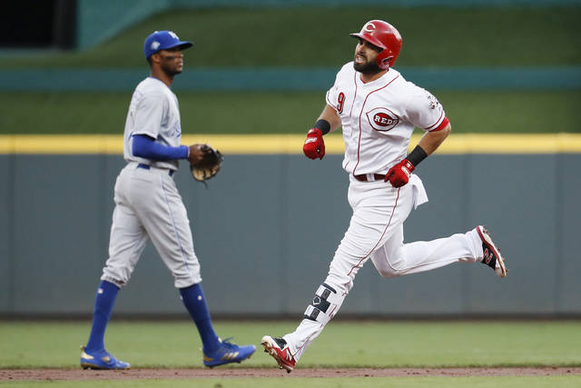 Cincinnati Reds' Jose Peraza runs the bases after hitting a solo home run off Kansas City Royals starting pitcher Heath Fillmyer during the first inning of a baseball game Wednesday, Sept. 26, 2018, in Cincinnati.