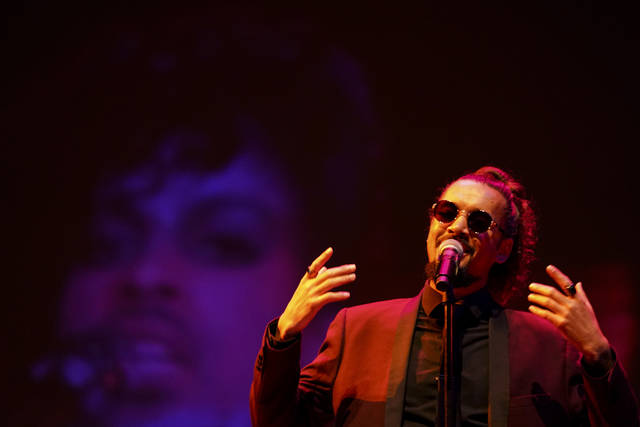 "Cameron Kinghorn sings ""Little Red Corvette"" during a ceremony awarding the late rock star Prince an honorary degree at the Ted Mann Concert Hall Wednesday, Sept. 26, 2018, in Minneapolis. The University of Minnesota awarded Prince an honorary degree to recognize his influence on music and his role in shaping his hometown of Minneapolis. (Aaron Lavinsky/Star Tribune via AP)"