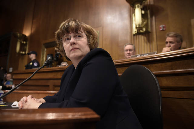 FILE - In this Thursday, Sept. 27, 2018 photo, Rachel Mitchell, a prosecutor from Arizona, waits for Christine Blasey Ford, the woman accusing Supreme Court nominee Brett Kavanaugh of sexually assaulting her, to testify before the U.S. Senate Judiciary Committee on Capitol Hill in Washington. On Friday, Sept. 28, 2018, The Associated Press has found that stories circulating on the internet that Mitchell helped help exonerate a Catholic priest facing sex crimes charges, are untrue. (Saul Loeb/Pool Photo via AP)