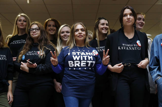 Supporters of Supreme Court nominee Brett Kavanaugh gather inside the Hart Senate Office Building on Capitol Hill in Washington, Thursday, Sept. 27, 2018. The Senate Judiciary Committee is hearing from Christine Blasey Ford, the woman who says Kavanaugh sexually assaulted her. (AP Photo/Patrick Semansky)