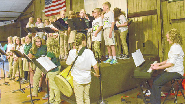 The Sts. Peter and Paul Catholic School Choir performed during the 150th anniversary celebration Sunday at the Ottawa Knights of Columbus Hall. Bryan Reynold | The Lima News