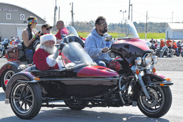Roger Sexton, a.k.a. Santa, leads more than 500 motorcyclists from the Allen County Fairgrounds on the 33rd annual ABATE Toy Run.