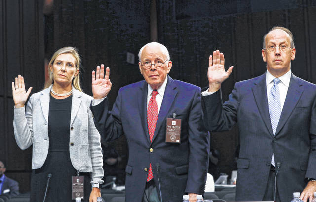 From left, Monica Mastel, John Dean, and Paul Clement, are sworn in before the Senate Judiciary Committee during the final stage of the confirmation hearing for President Donald Trump's Supreme Court nominee, Brett Kavanaugh, on Capitol Hill in Washington, Friday, Sept. 7, 2018.