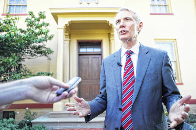 """Sen. Rob Portman, R-Ohio, is interviewed outside the William Howard Taft National Historic Site, Friday, Sept. 14, 2018, in Cincinnati. Portman, who's been a strong advocate for Supreme nominee Brett Kavanaugh, remains confident he will be confirmed after a """"way too partisan"""" battle in Washington."""
