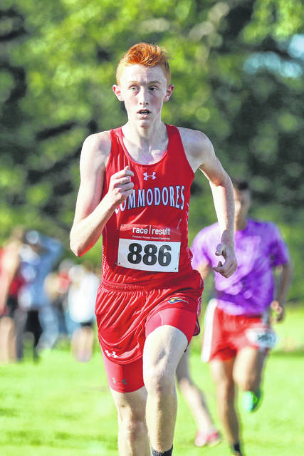 Perry's Freshman Braden Yingst finishes the race to capture first place at the Bath Cross Country Invitational on Wednesday evening.