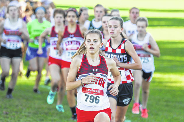 Kenton's Kierra Krohmer leads the pack at the beginning of the race, a position she would hold until the end where she captured first place at the Bath Cross Country Invitational on Wednesday evening.