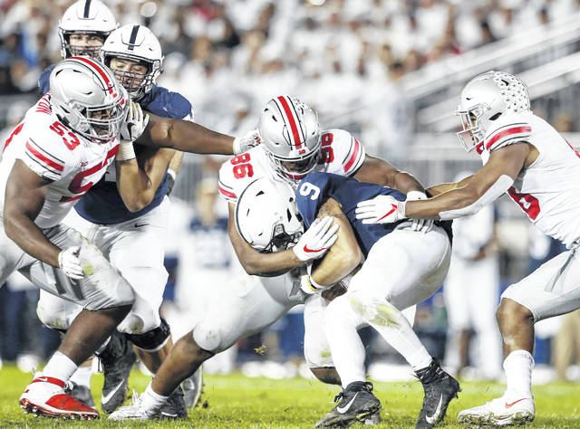 Penn State quarterback Trace McSorley (9) is sacked by Ohio State's Dre'Mont Jones (86) during the second half of an NCAA college football game in State College, Pa., Saturday.