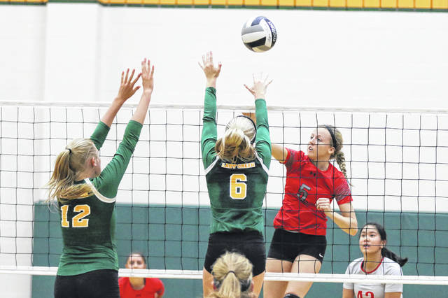 Ottoville's Taylor Beining, left, and Quinley Schlagbaum block the spike from Columbus Grove's Rylee Sybert on Monday evening at Ottoville. Columbus Grove won 3-1 with scores of 25-16, Ottoville 25-27, 25-23 and Grove 26-24.