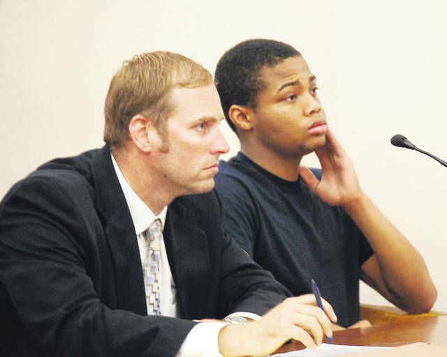 Daquan Green, who recently turned 18 years of age, was sentenced Wednesday to 14 years in prison for a pair of armed robberies he committed in Lima late last year. He is pictured with his attorney, Zachary Maisch.