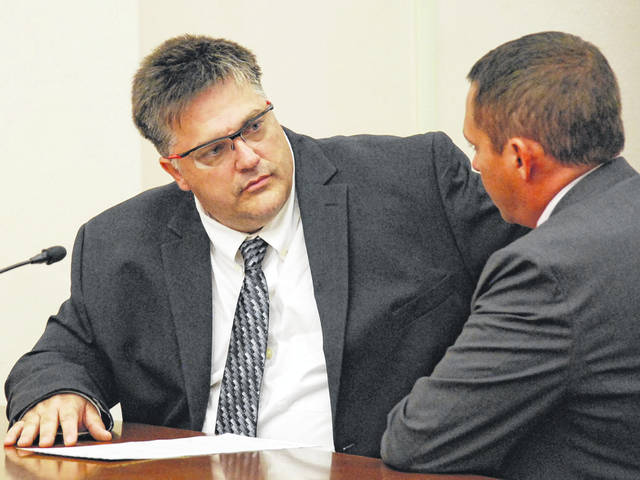 Jeremie Fuson confers with his attorney, Ryan Reed, during a sentencing hearing on Monday in Allen County Common Pleas Court. Fuson was sentenced to 18 months in prison on charges of gross sexual imposition. Protesters gathered outside the courthouse prior to Monday's hearing in objection to a plea deal offered to Fuson by prosecutors.