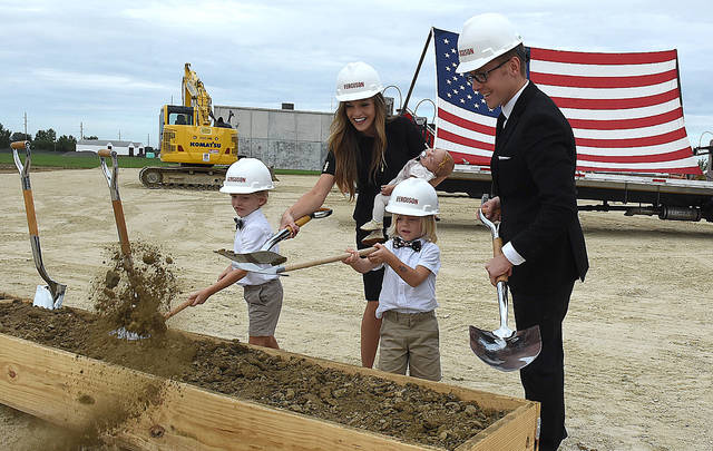 Nick Kennedy, far right, breaks ground for his new $4 million, 55,00 sq., ft. Flex Arm facility in Wapakoneta with his wife, Ashley and three children, Weston, 6, Warren, 4, and Vanna, three-months. Craig J. Orosz | The Lima News