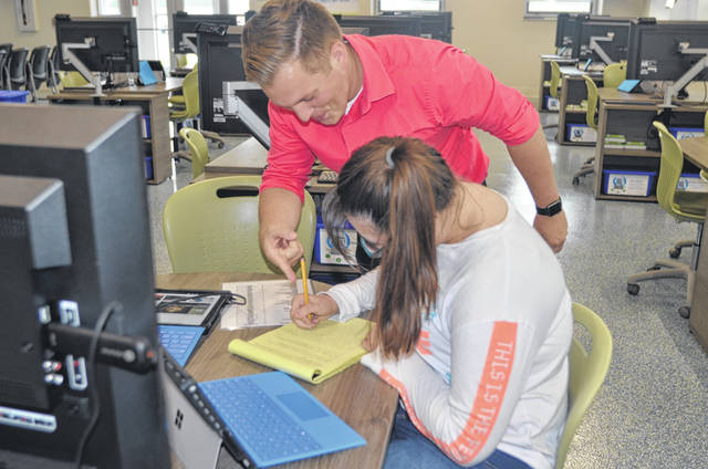 OhioMeansJobs- Allen County job coach Brock Schmidt discusses career ideas with Delphos Jefferson High School senior Gabrielle Fowler at the Career Connections Student Center at Delphos Jefferson High School.