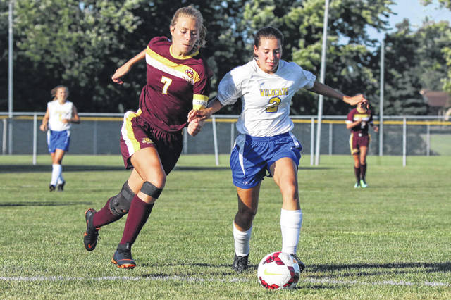 Miller City's Abi Reyna (2) attempts to defend Kalida's Lauren Langhals (7) as she advances towards the goal on Wednesday evening.