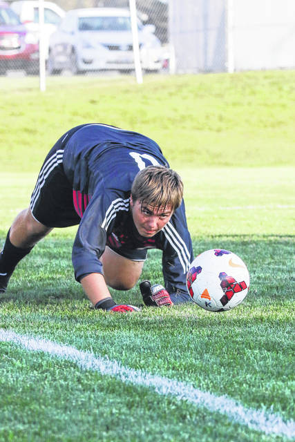 St. Marys' goalie Correy Nelson chases a loose ball after blocking a shot during Tuesday night's match against St. Marys in Kalida.