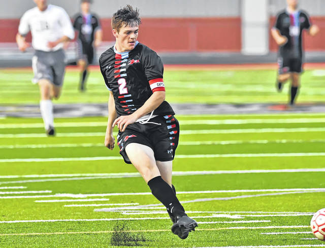 Lima Central Catholic's Trey Horstman scores a goal during Tuesday night's match against Temple Christian at Spartan Stadium. See more match photos at LimaScores.com.