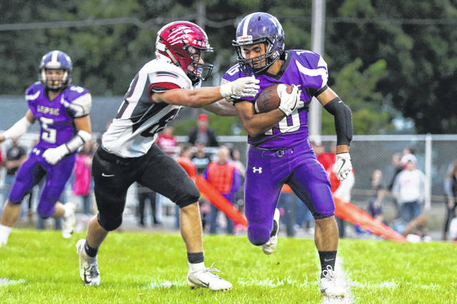 Leipsic's Anthony Roman tries to shake McComb's Robert Odell during Friday night's Blanchard Valley Conference game at Leipsic.
