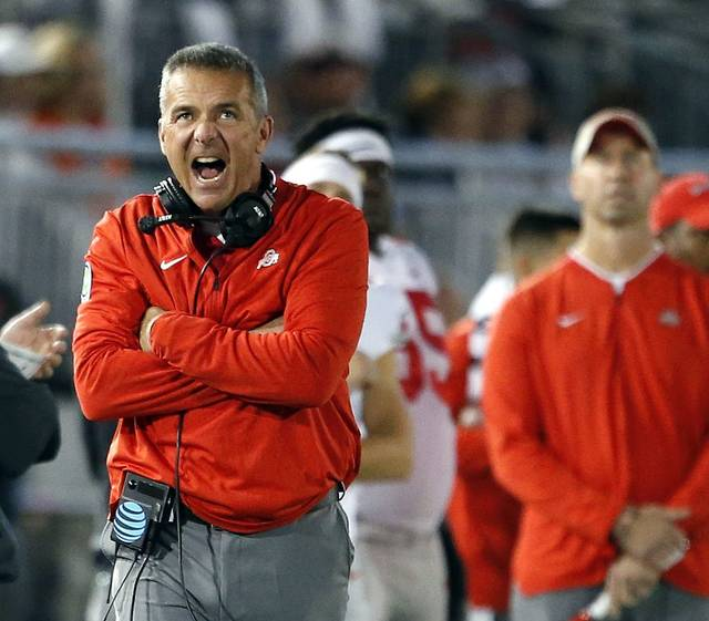 Ohio State head coach Urban Meyer, reacts after Penn State gets a first down during the first half of an NCAA college football game in State College, Pa., Saturday.