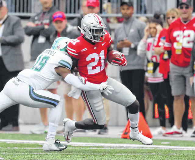 Ohio State's Paris Campbell Jr. tries to shake Tulane's during Saturday's game at Ohio Stadium in Columbus.