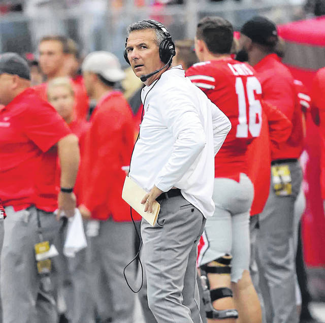 Ohio State head coach Urban Meyer was back on the sidelines Saturday at Ohio Stadium in Columbus after serving a three-game suspension.