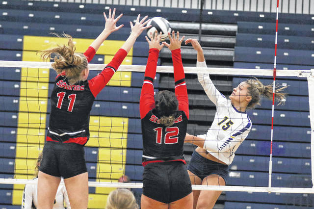 Ottawa-Glandorf's Taylor Alt hits a spike against Shawnee's Amber Greeley (11) and Peyton Deubler during Thursday night's Western Buckeye League match in Ottawa. See more match photos at LimaScores.com.