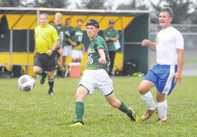 Ottoville's Nolan German shoots and scores against Continental's Luke Recker during Monday's match at Ottoville.