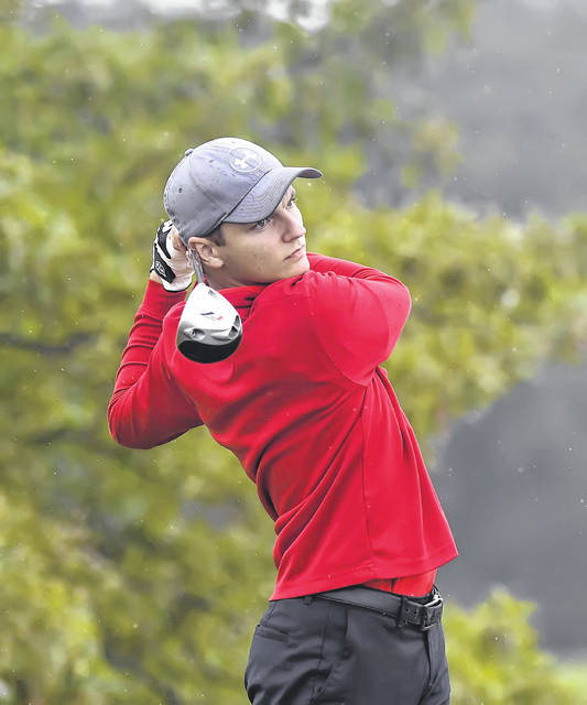 Columbus Grove's Jacob Olgesbee plays his shot from the second tee during Monday's PCL Golf Championship at Pike Run Golf Club. The Bulldog linkster carded an 84.