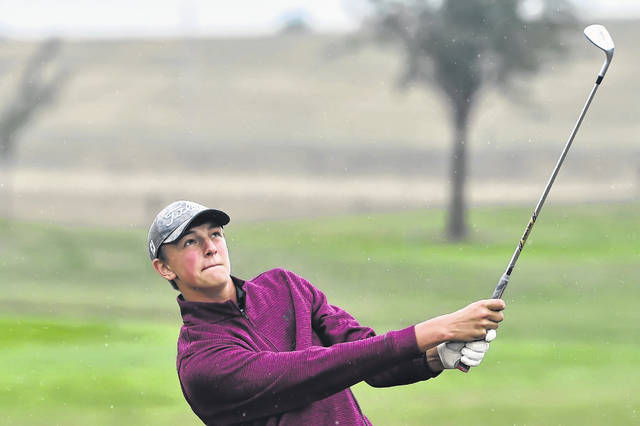 Kalida's Christian Nartker watches his second shot during Monday's PCL Golf Championship at Pike Run Golf Club. Nartker shot a 74 to win the PCL medalist honors.