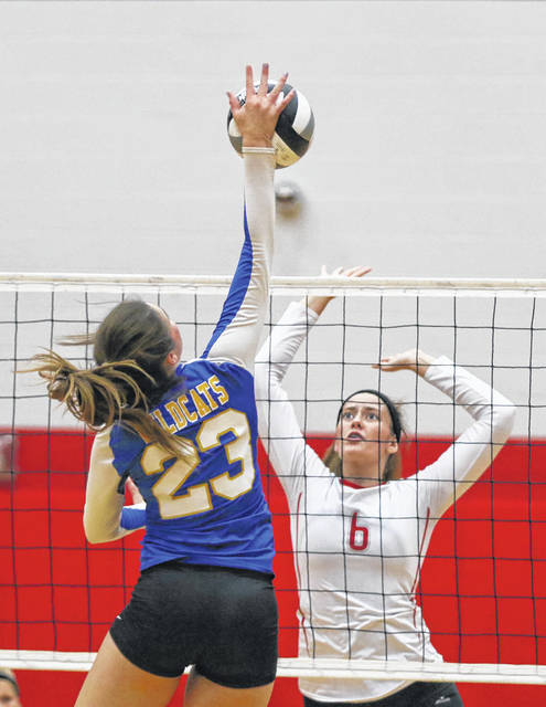 Miller City's Katelyn Kuhlman hits a spike against Pandora-Gilboa's Makayla Kinsinger during Tuesday night's match at Pandora-Gilboa.