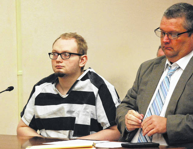 A tentative jury trial has been scheduled for Feb. 19 in Allen County Common Pleas Court for Perry Jones, 22, of Lima, who faces 19 sex-related charges. He is shown in court Wednesday with his attorney, John Hopkins, during a hearing in which Perry was ruled competent to stand trial.