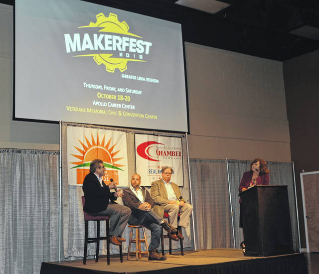 Holly Geaman, of Your Hometown Stations, hosts a discussion between Doug Arthur of LinkLima, Tony Daley of Spallinger Millwright and Greg Myers of Wapakoneta Area Economic Development Council about ways to fill jobs in the region during Real American Sunrise Friday at Veterans Memorial Civic Center.