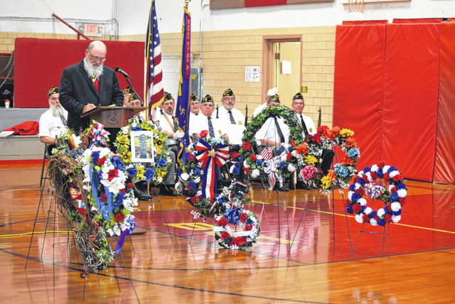 David Lupien, secretary of the NW Territory Chapter, Ohio Society, Sons of the American Revolution leads a ceremony Saturday morning in the Pandora Community Center to honor Israel Hubbard Jr., a Revolutionary War soldier that was buried in the Malahan Cemetery near Pandora.