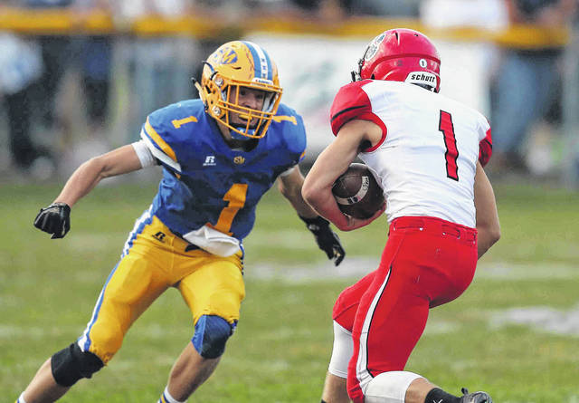 St. Marys' Carter Ballweg sets his sights on tackling Kenton's Jayden Cornell during Friday night's game in St. Marys. Cornell tallied 14 catches for 104 yards and two touchdowns for the Wildcats.