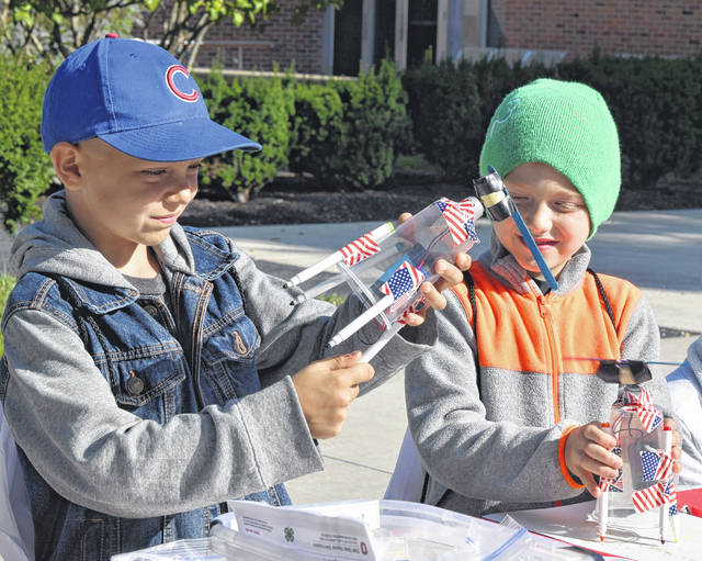 Brothers Preston,8, and Witten, 6, Brinkman of Lima create an art-bot at The Ohio State University-Lima's Steam on the Quad Event Saturday.