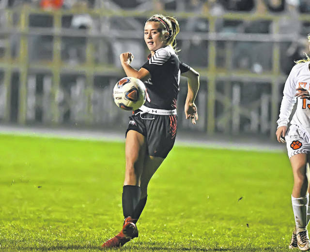 Shawnee's Sophia Fusillo scores a goal during Thursday night's Western Buckeye League match against Elida at Shawnee High School.