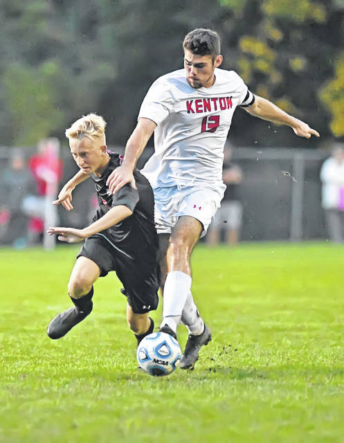 Shawnee's Ethan Rosebeck tries to keep Kenton's Isaac Mendez from getting to the ball during Tuesday night's Western Buckeye League match at Shawnee High School.