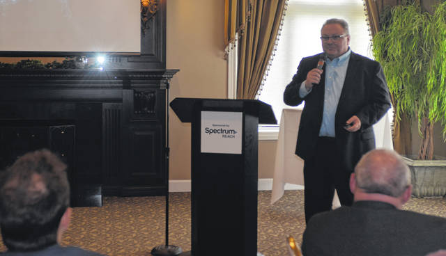 Spectrum Reach Local Sales Manager Dino Gerdeman discusses marketing data for businesses during the Connections event at Shawnee Country Club on Thursday.